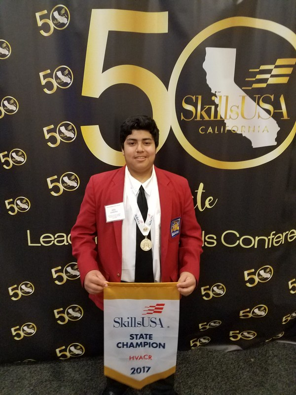 Photo of Joel Ledesma after his Gold Medal Win at SkillsUSA Competition