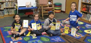Students holding a craft for Texas Reads One Book