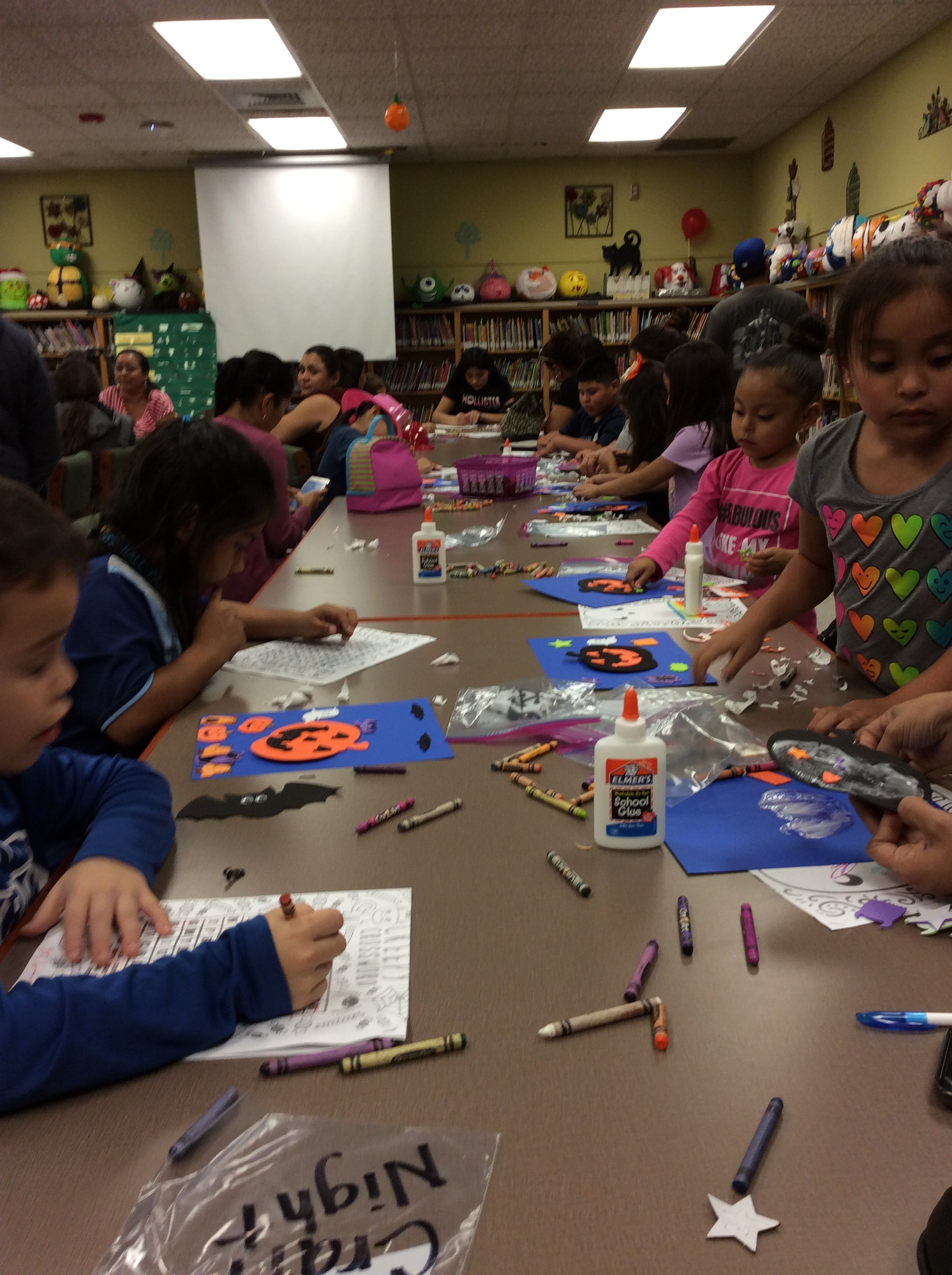 Students working on crafts in library.
