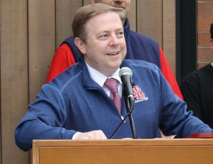 Man standing behind microphone