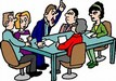 adults sitting around a table conversing