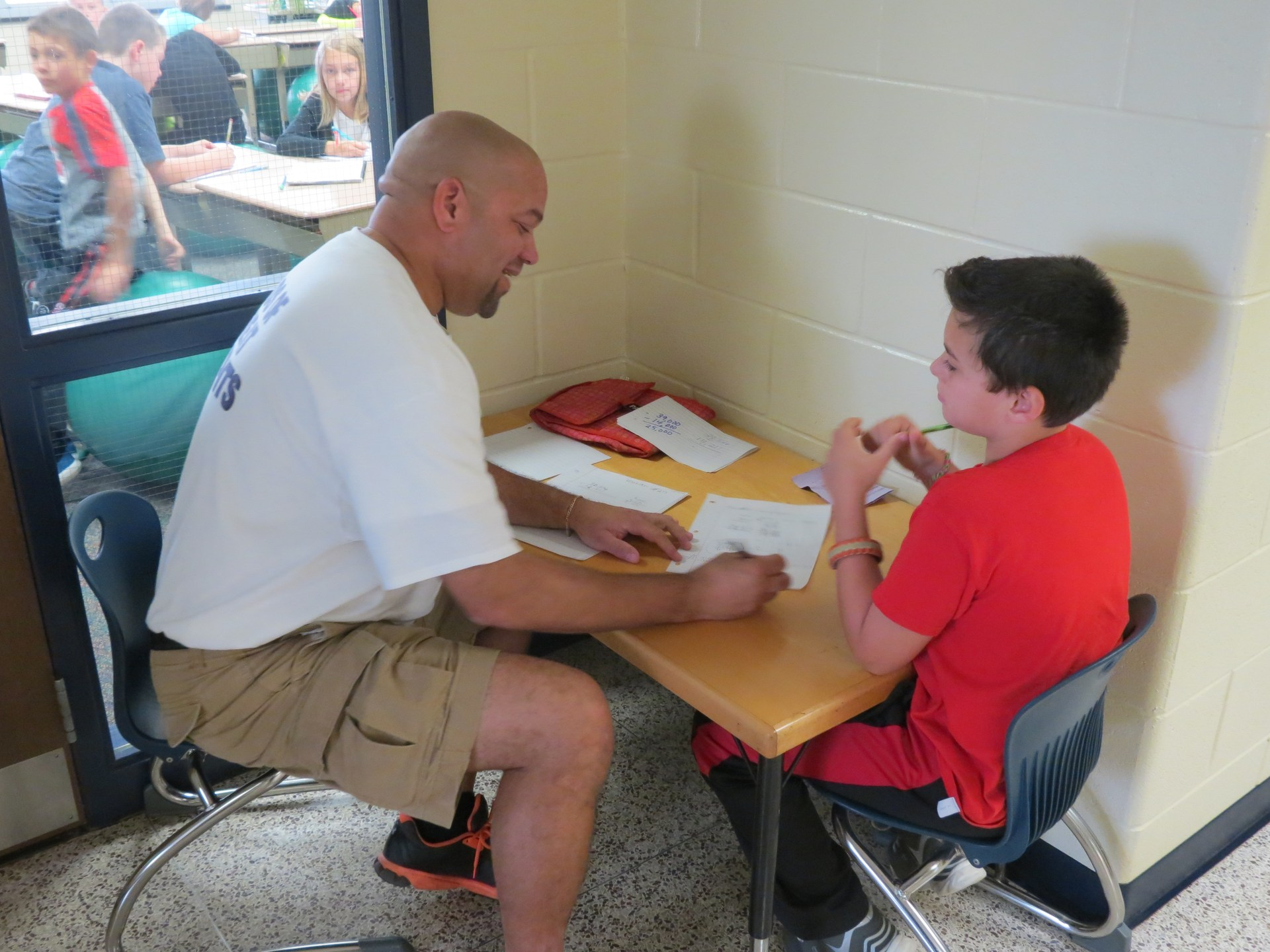 A watchdog works one on one with a student.