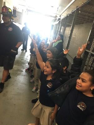fireman answering children's questions