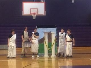 DI team practicing in togas
