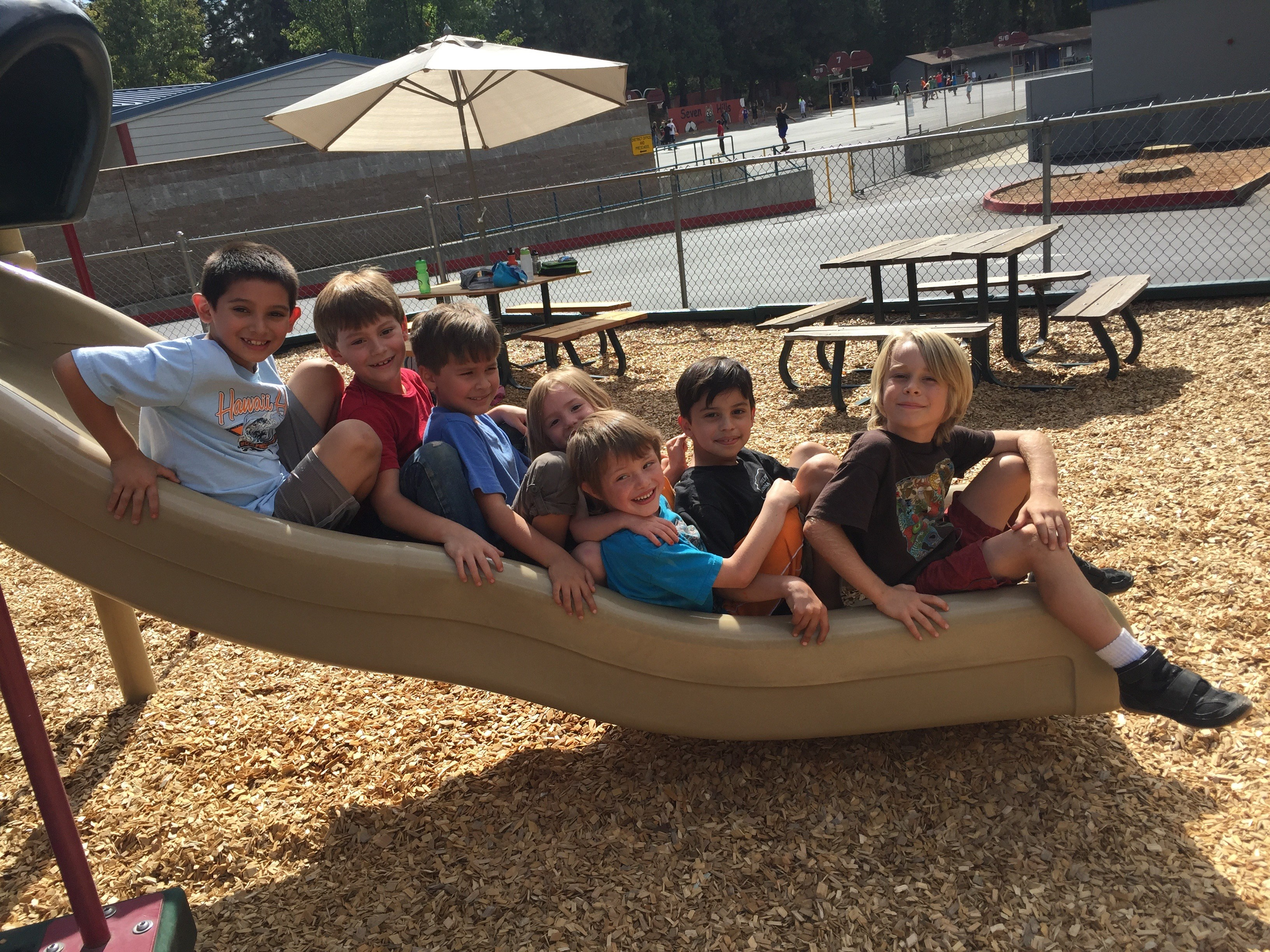 Students smiling on slide