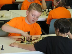 A Page Elementary student makes a chess move at the TK chess tournament.
