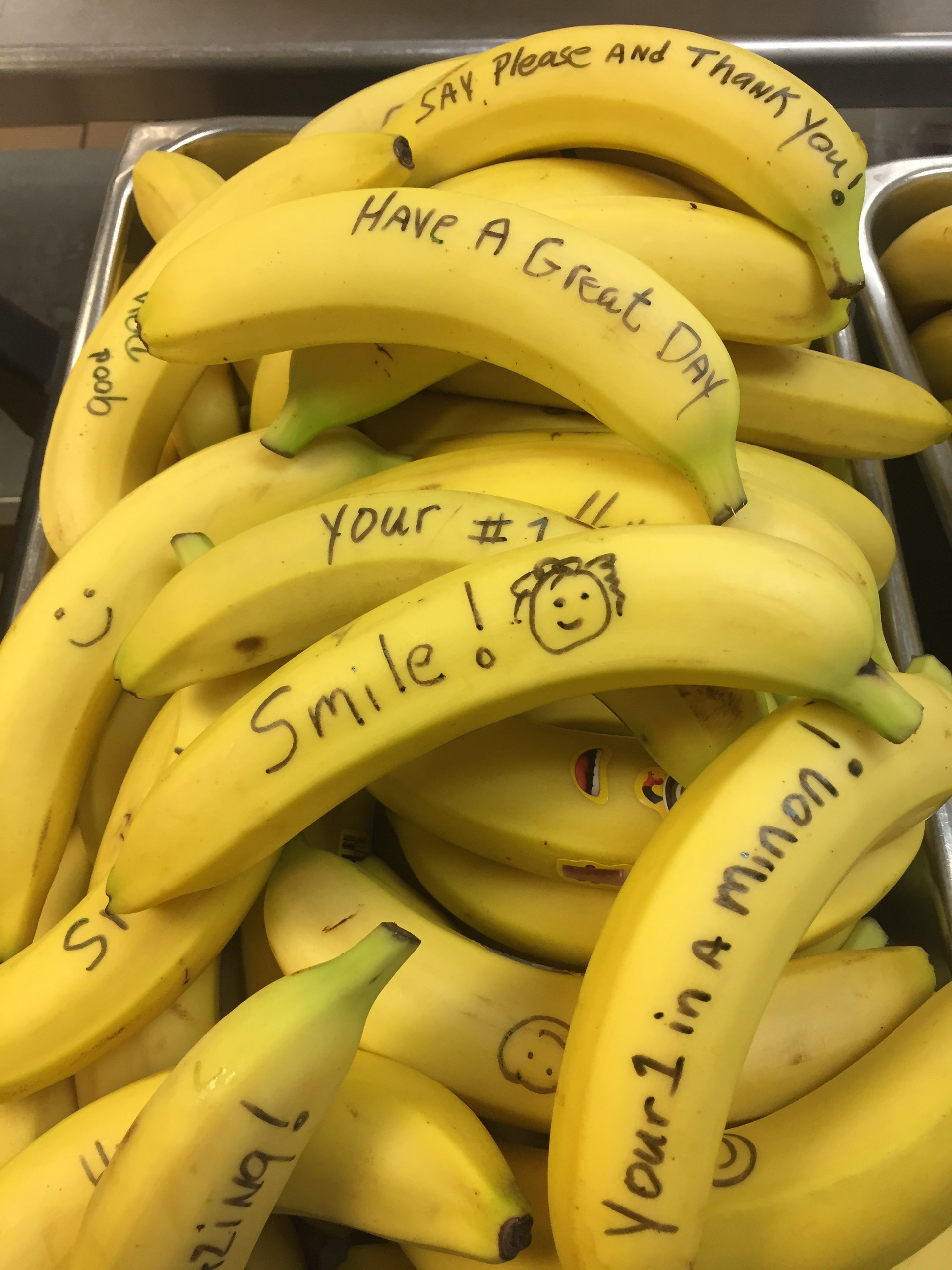 Bananas with motivational quotes written on them such as Smile! and your #1.