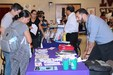 South Texas College representative speaking to parents at his table.