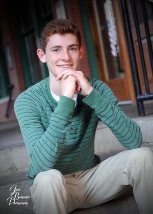 senior photo of boy sitting on step