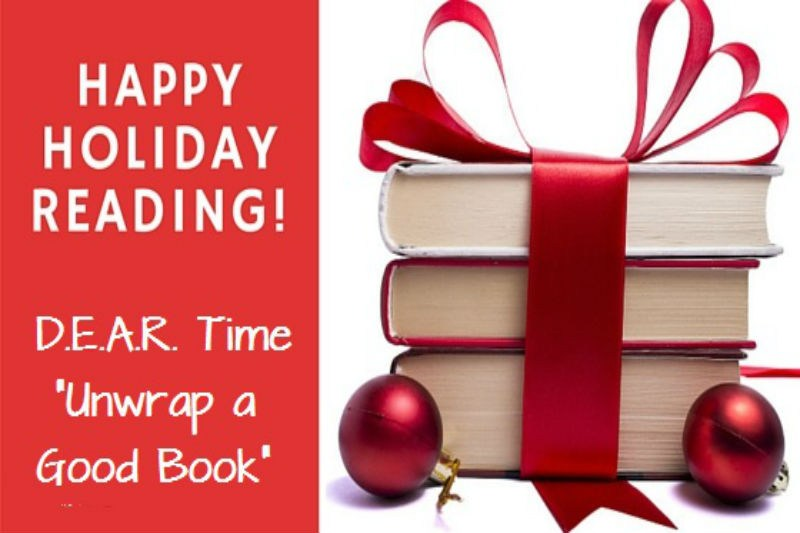 A picture of bow wrapped books with the words HAPPY HOLIDAY READING. D.E.A.R. Time