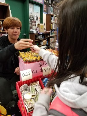 one person purchasing a book from another person at a book fair