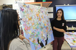 Students explain their butterfly collage