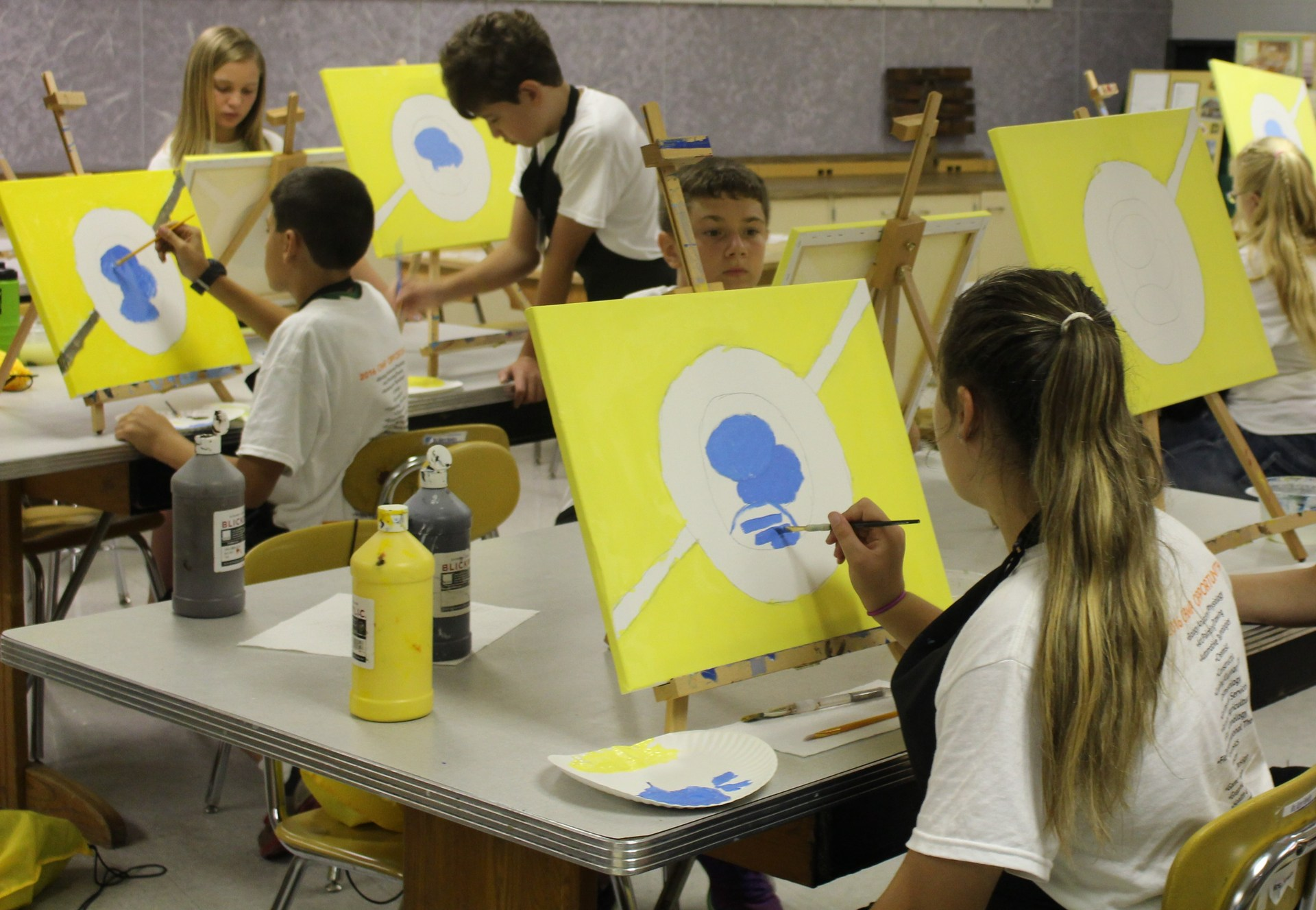 Students painting at Camp Opportunity