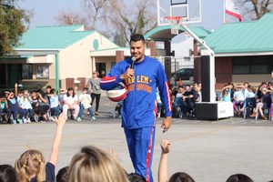 El Gato talks to the students about basketball and bullying