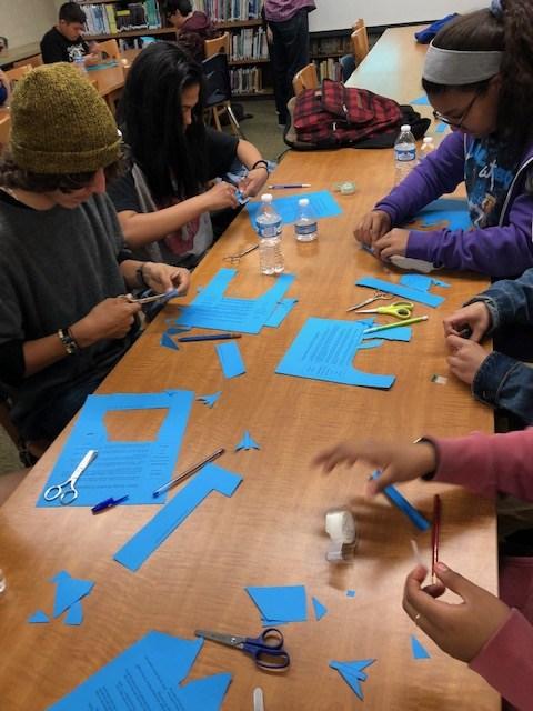 Students making straw rockets 4