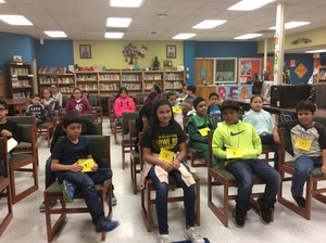 Students waiting to compete in the library.
