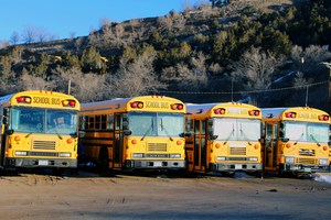 Row of 9-R school buses.