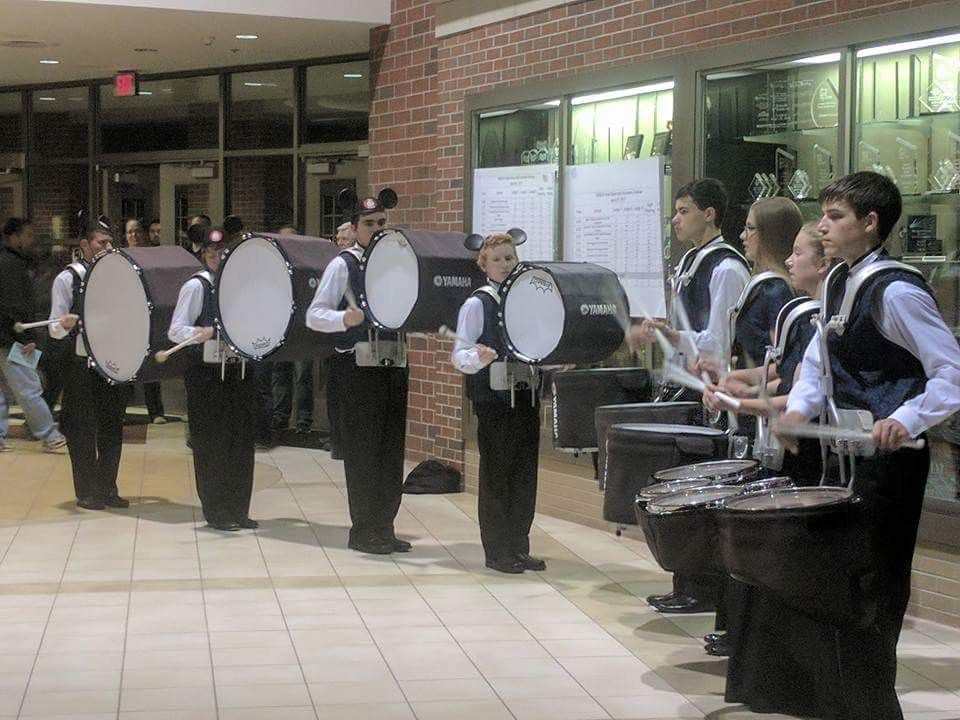 The drum line performs during the collage concert.
