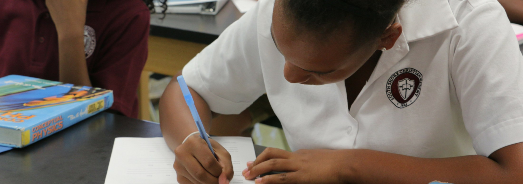 Student working at her desk