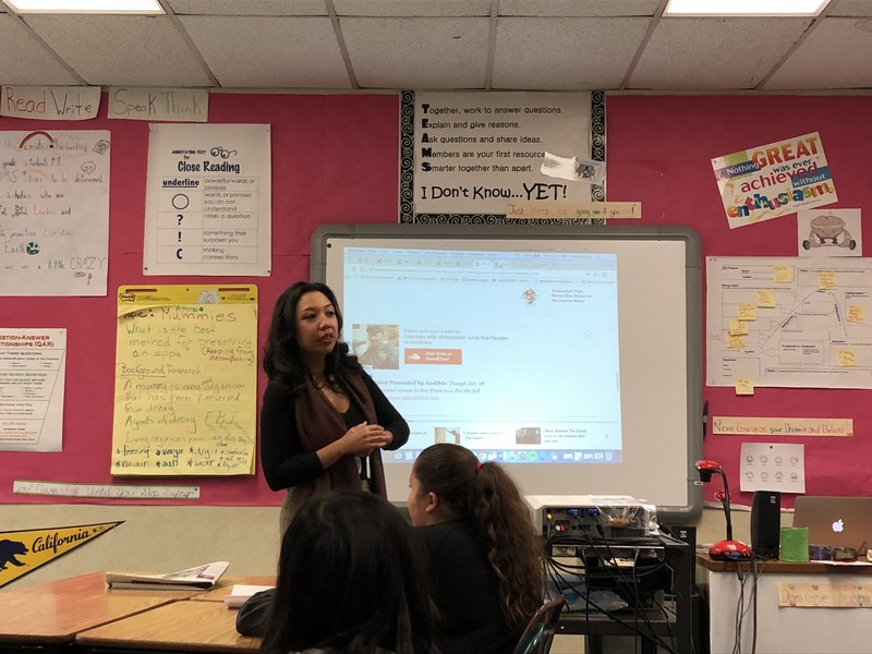 reporter speaking to a classroom of students