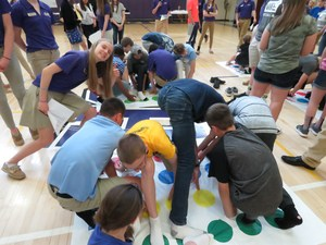 Members of the incoming class of 2022 play Twister at Welcome Night