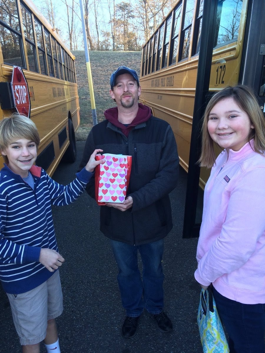 Middle school students appreciating bus drivers