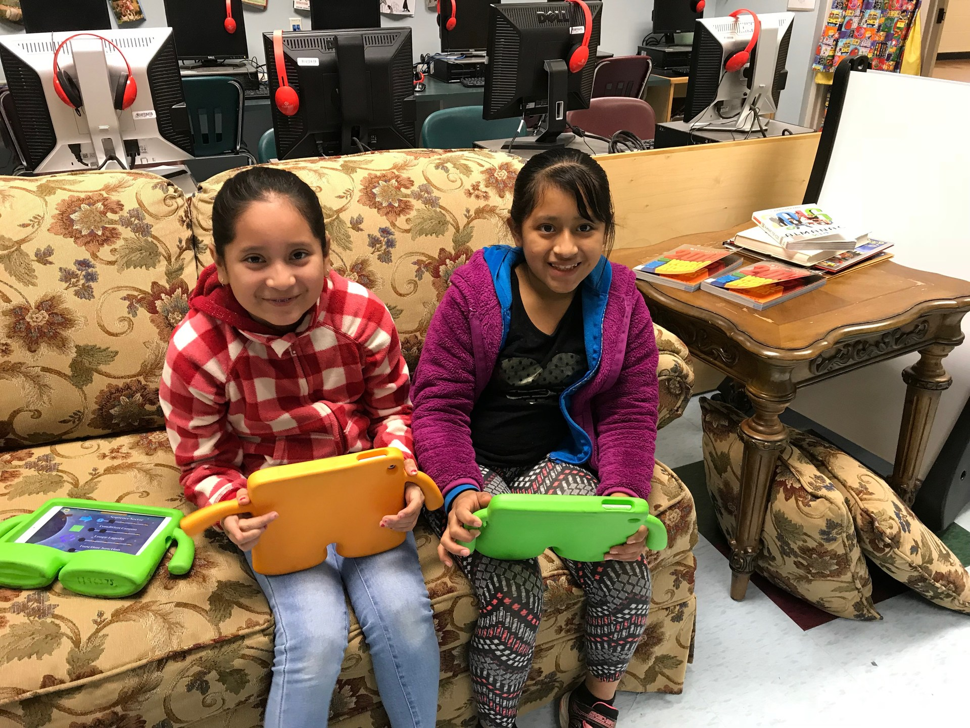 Two students participating in Hour of Code