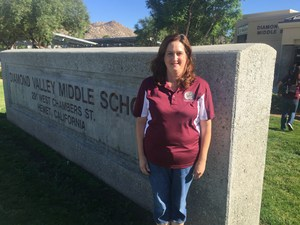Lisa Thornbury in front of the Diamond Valley sign