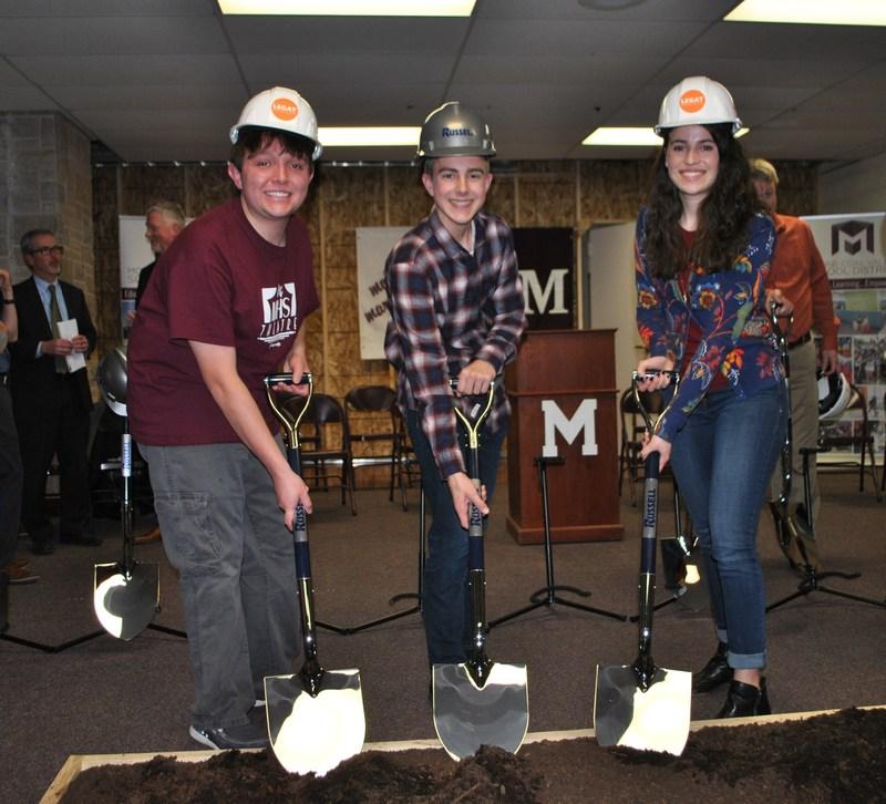 Photo of students holding shovels.