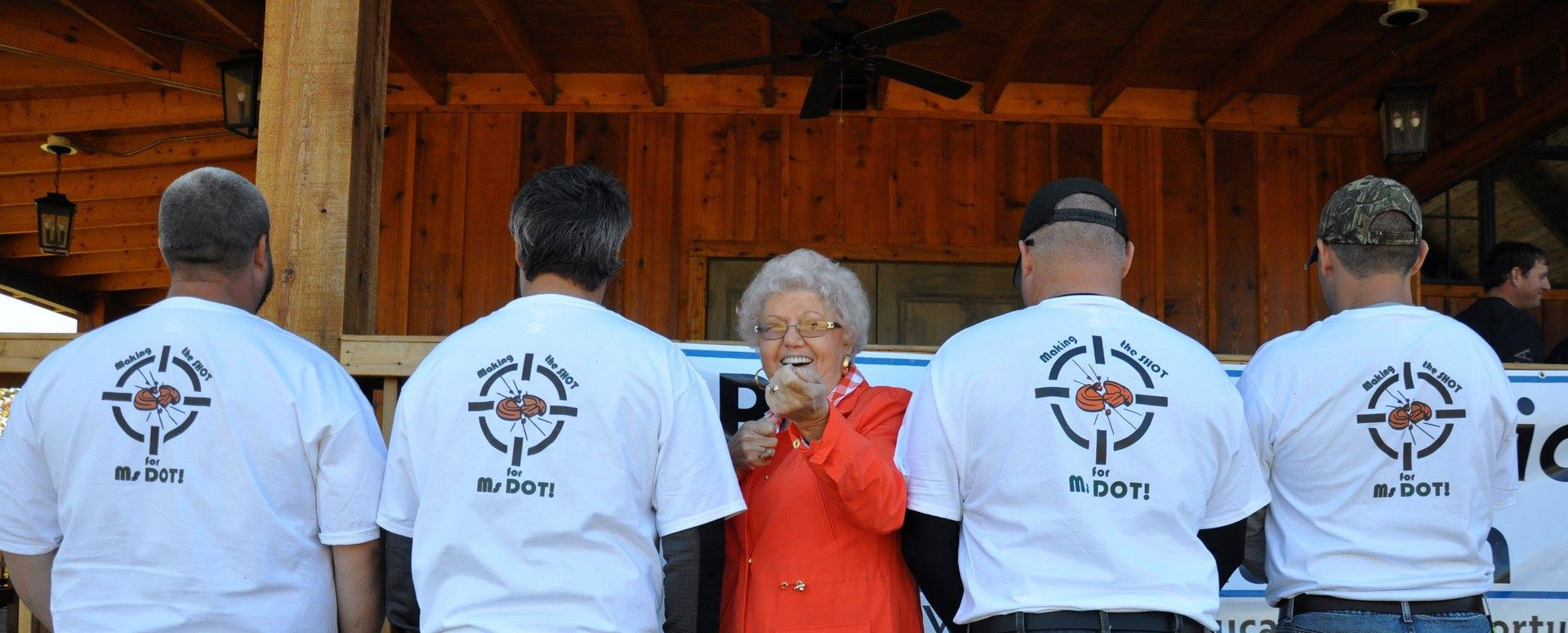 Ms. Dot pictured with Clay Shoot Participants