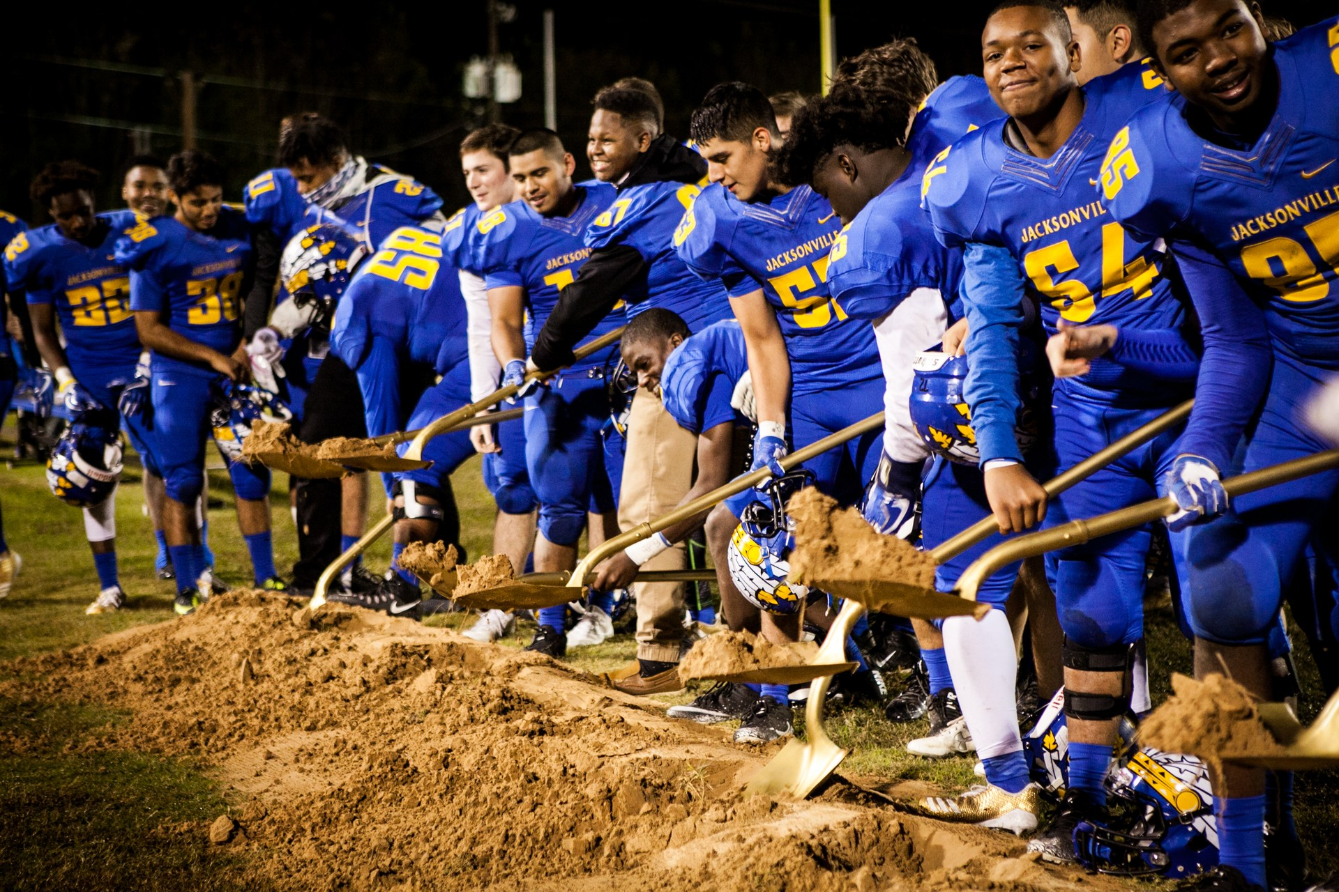 Football team breaking ground