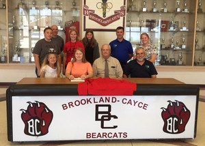 Coaches, family members and fellow players joined Cristen Hipp, seated second left, at her signing last week.