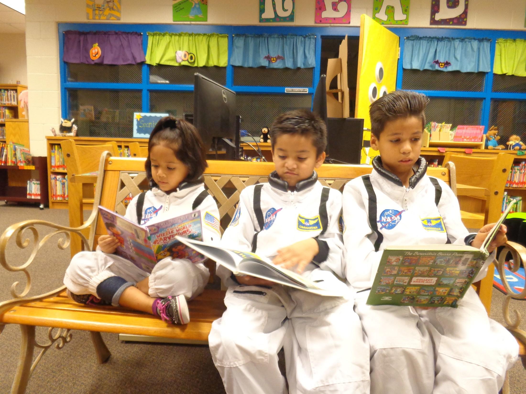 three students reading