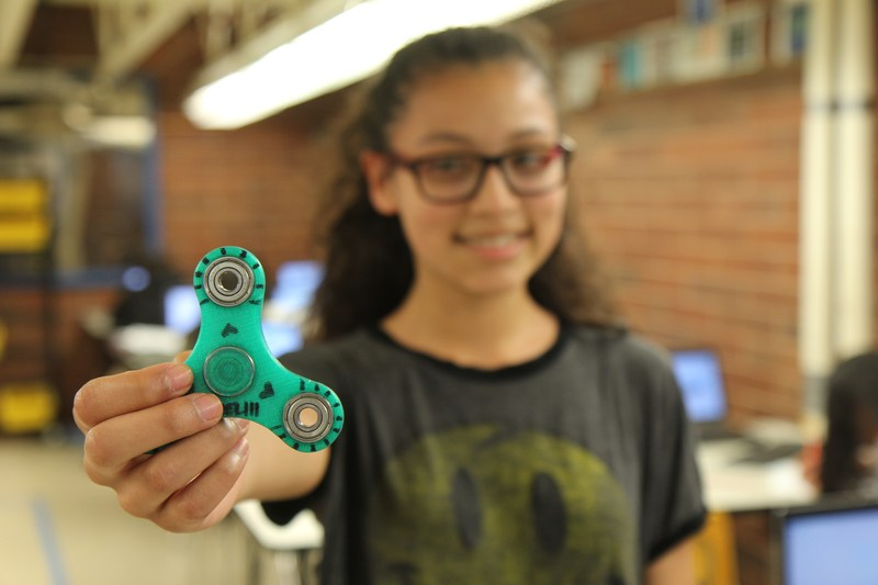 Middle School Student shows off a fidget spinner she created