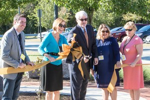 Administration cutting ribbon