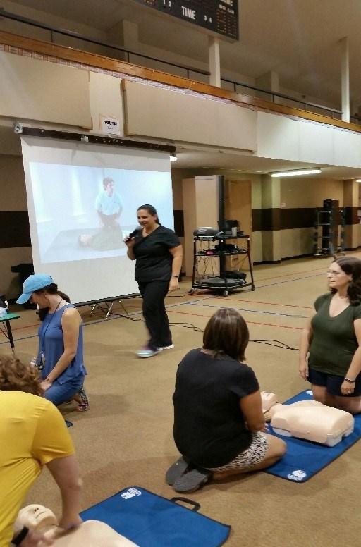 Parent Volunteer Teaching CPR/First Aid Class