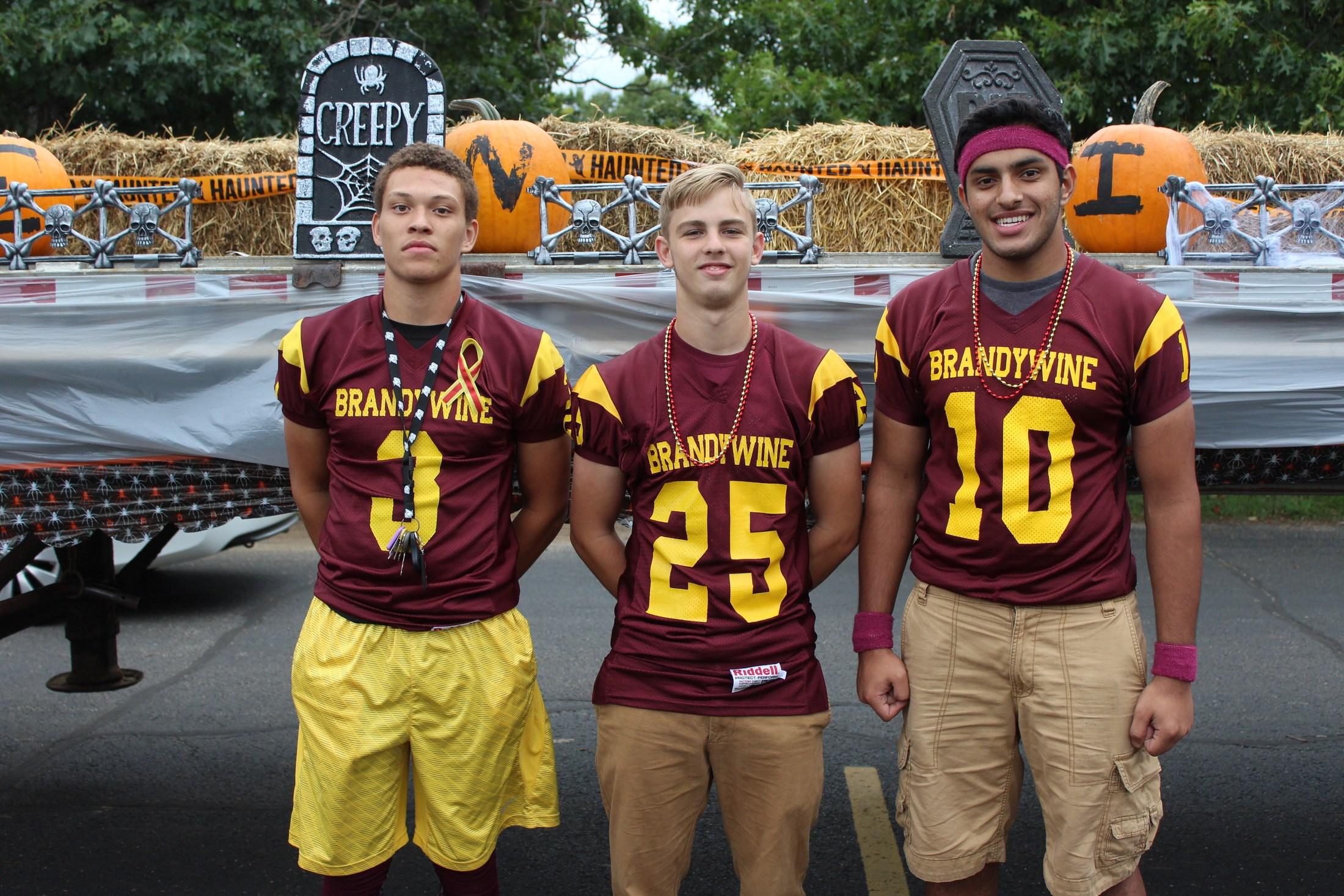 Football players at homecoming parade