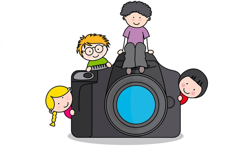 Camera with children sitting on top.