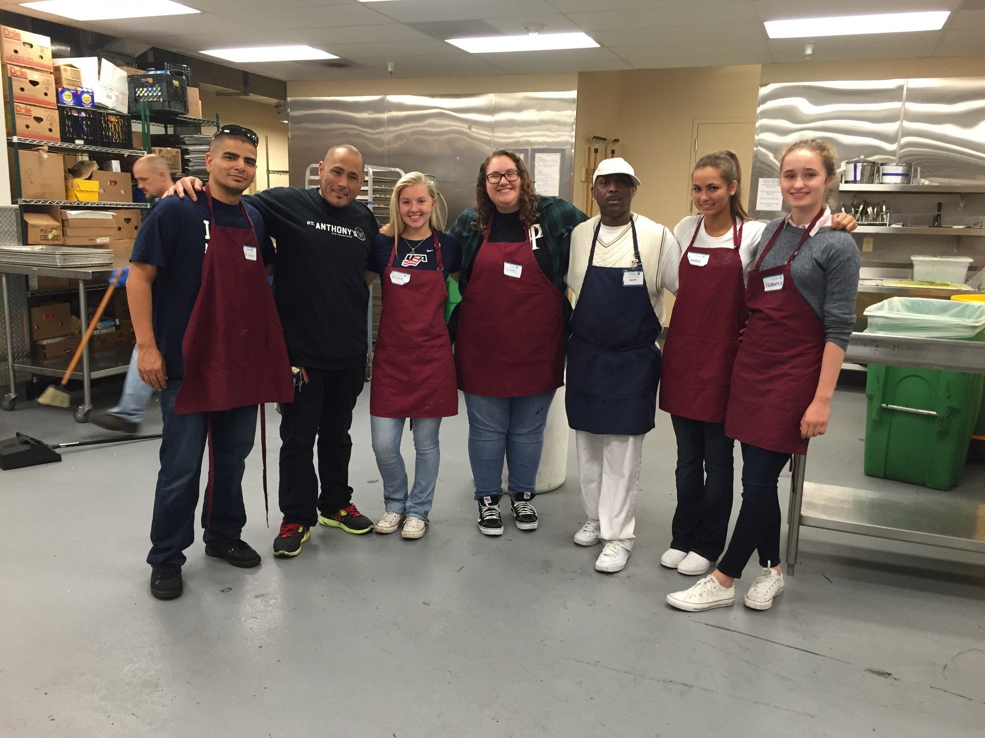 Students and staff volunteering at St. Anthony's Dining Room