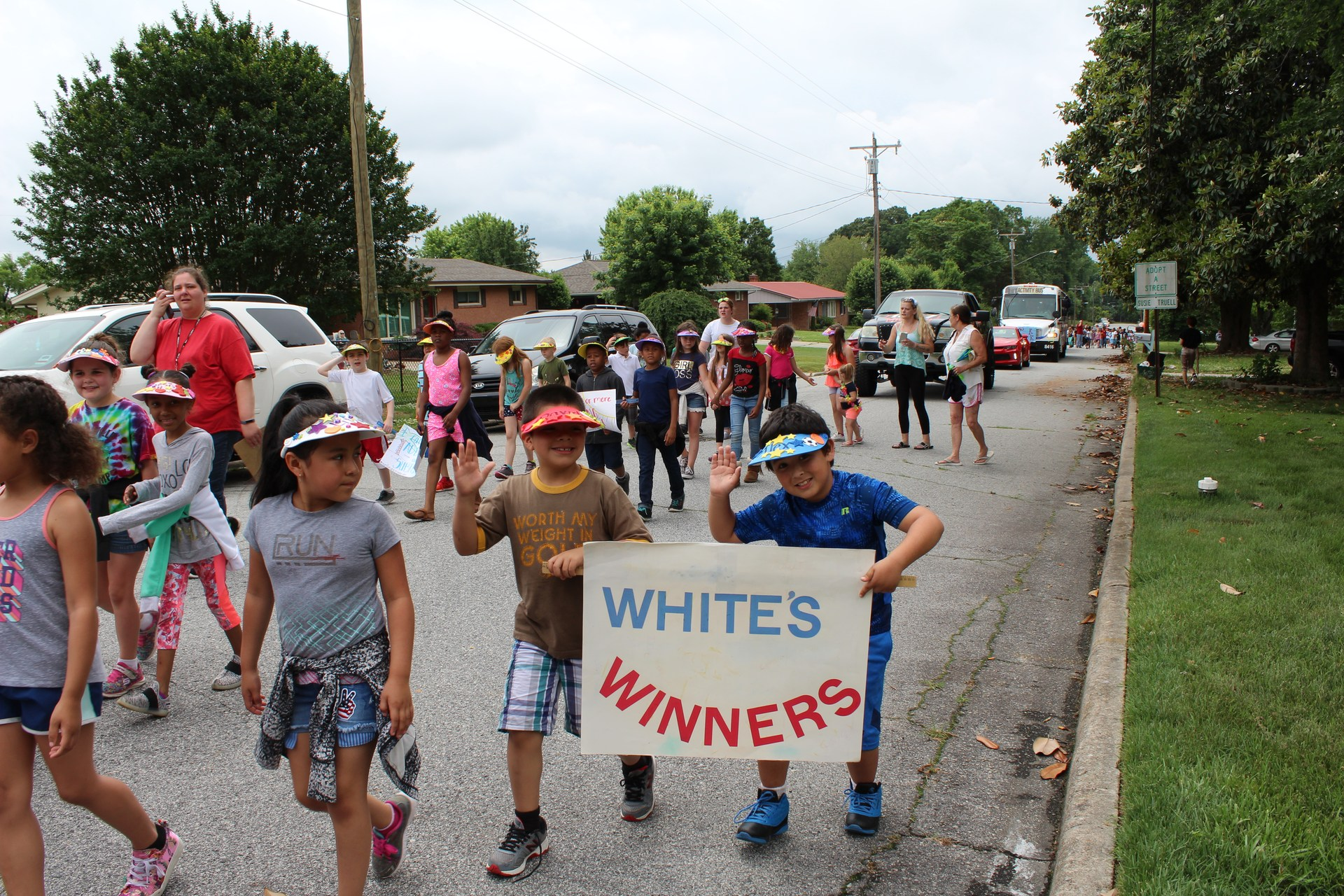 Ms. White's class marching with banner