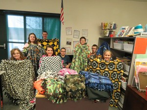 Middle school students make blankets for young hospital patients.