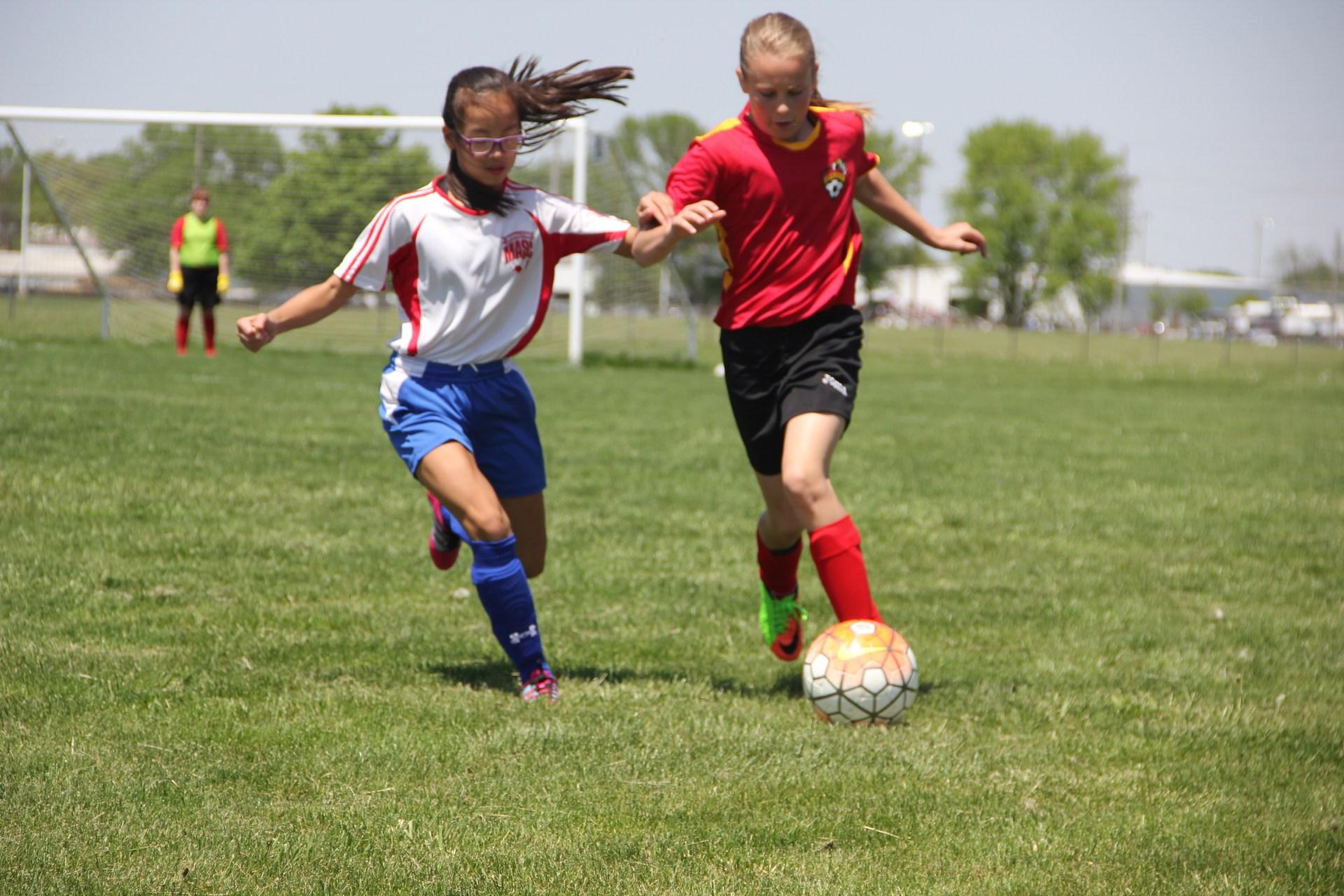 Riley playing soccer