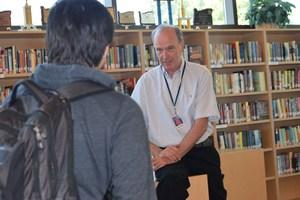 Man talking to student