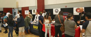 Students asking questions to the Army, Marine Corps, Navy, and Air Force representatives.