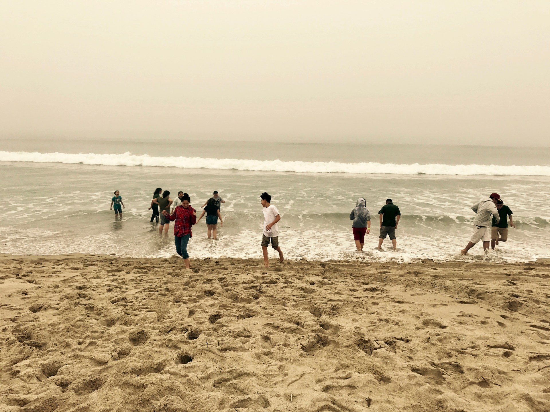 Students play on the beach