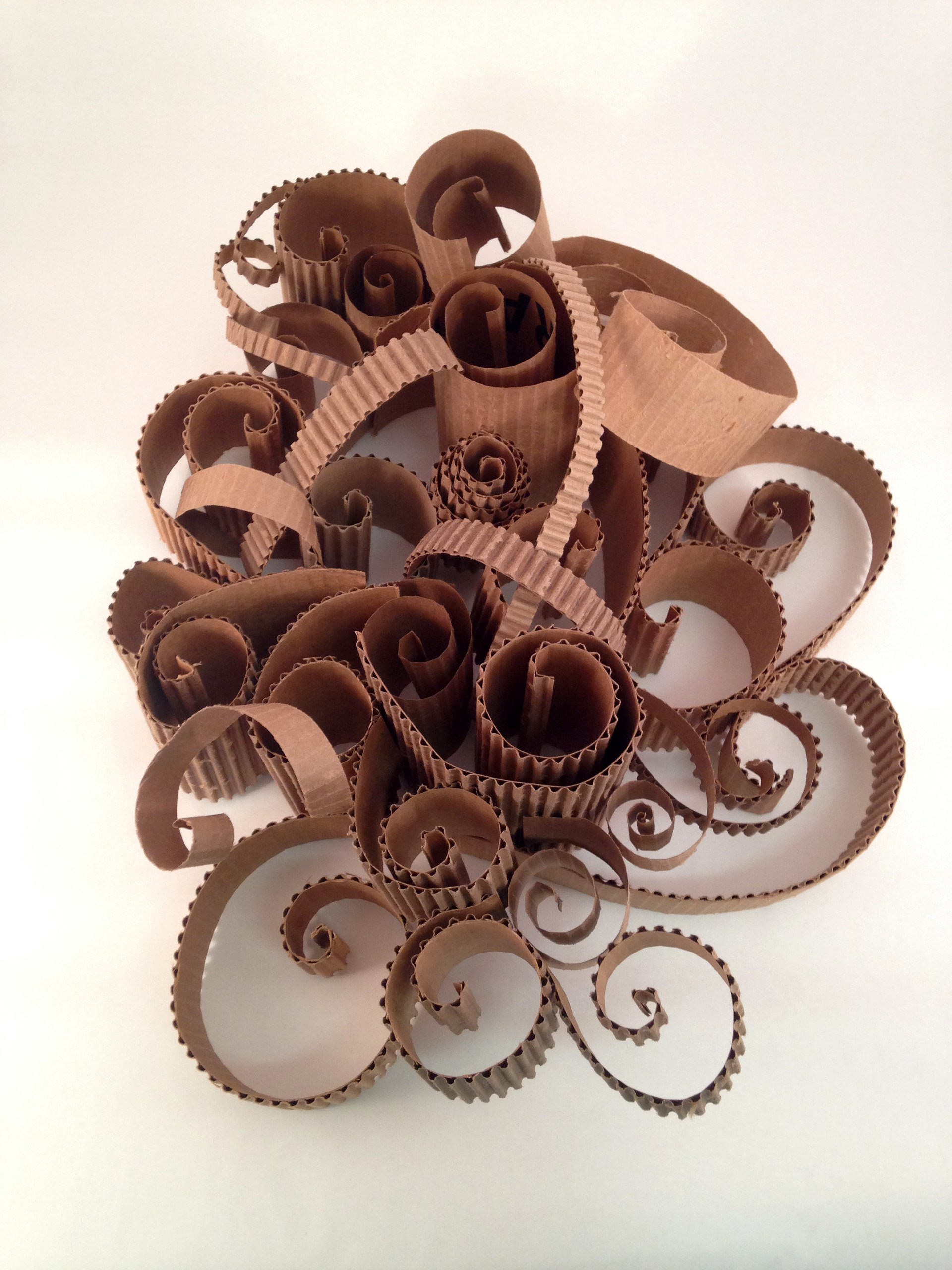 cardboard sculpture with swirled layers