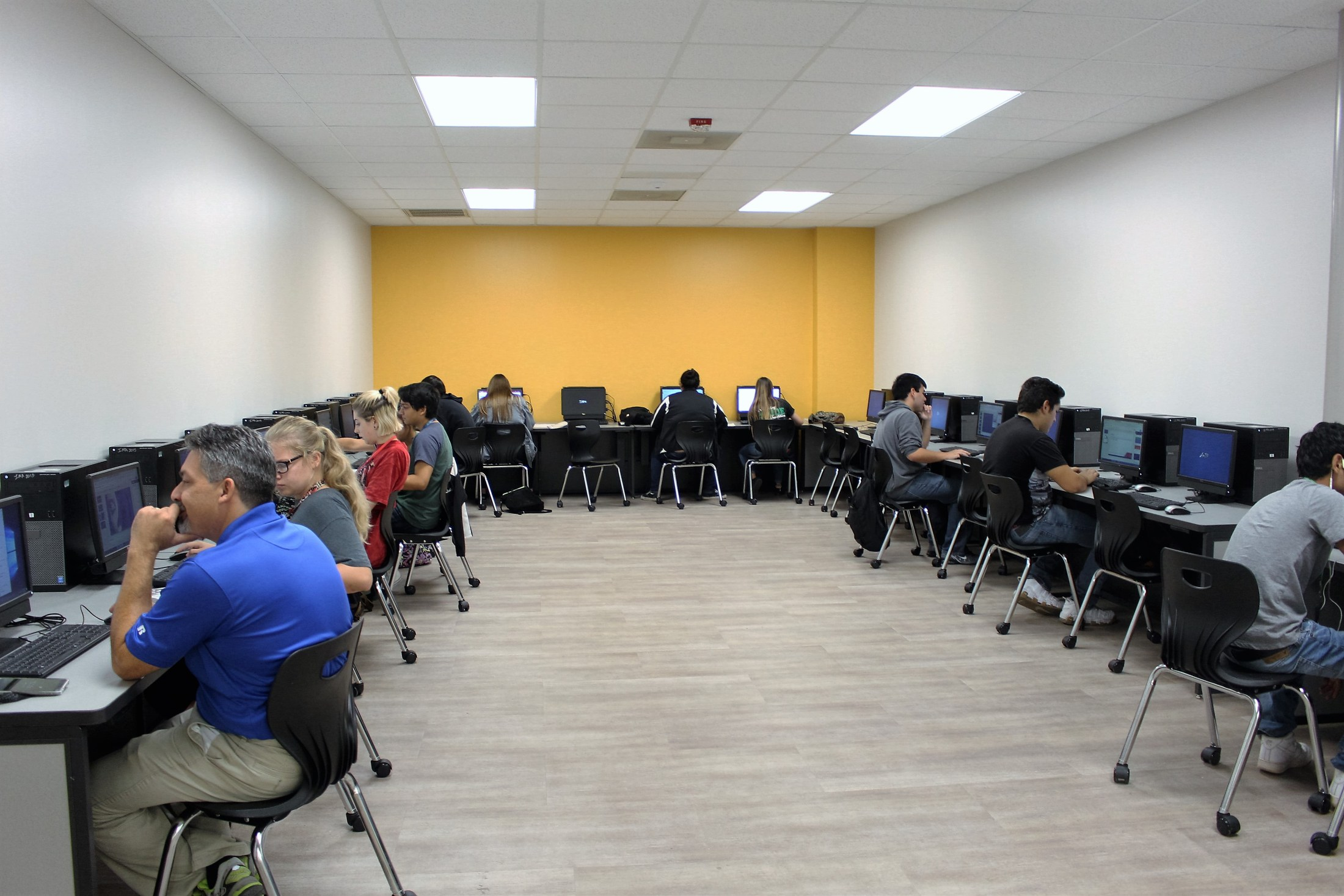 A class of students sitting at computers.