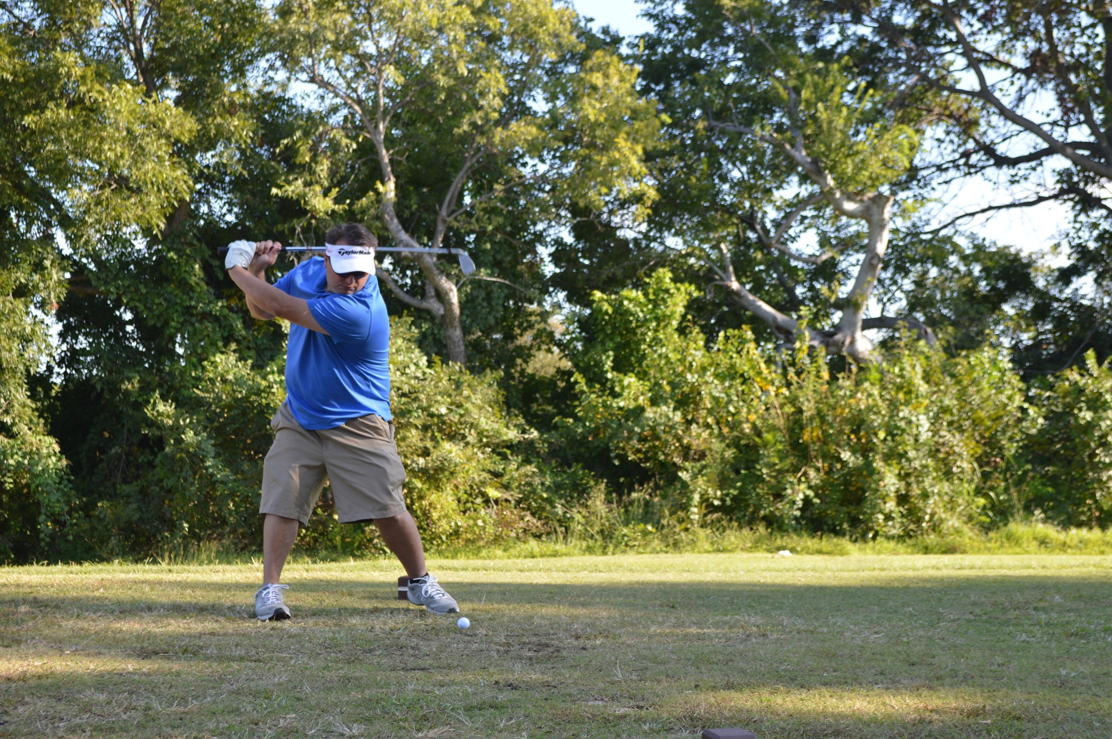 Golf Tournament: On the course, swinging clubs