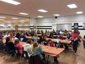 Students sitting in cafeteria during V.I.P. breakfast.