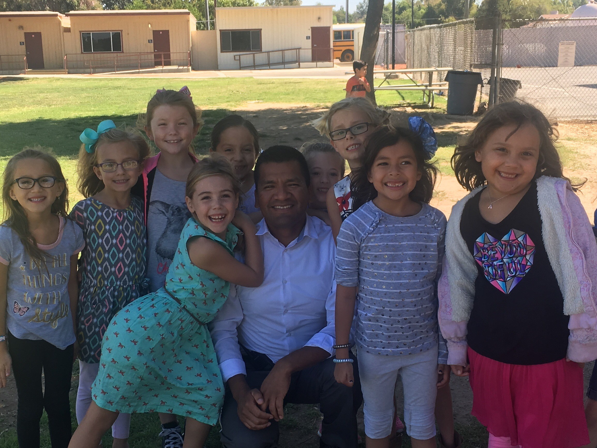 Principal Lopez and a group of first grade students